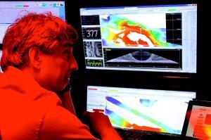 Christopher Kelley monitoring incoming data in the sonar control room. Credit: Dan Wagner/NOAA